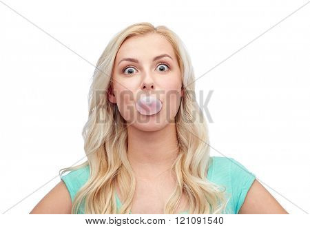 emotions, expressions and people concept - happy young woman or teenage girl chewing gum