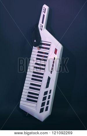 Synthesizer on dark background