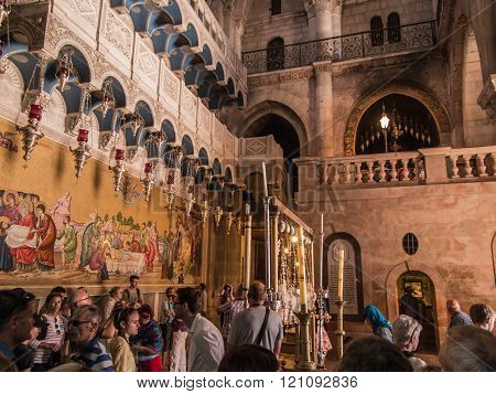JERUSALEM - July 15: Stone of the Anointing of Jesus in the Holy Sepulchre the holiest place of Christians July 15 2015. Jerusalem Israel