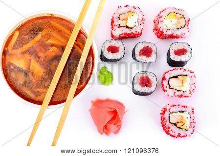 WOK soup - rice noodles, tofu, tomato-based and Sushi.