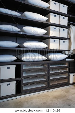 expensive shelving in the boutique with pillows and boxes