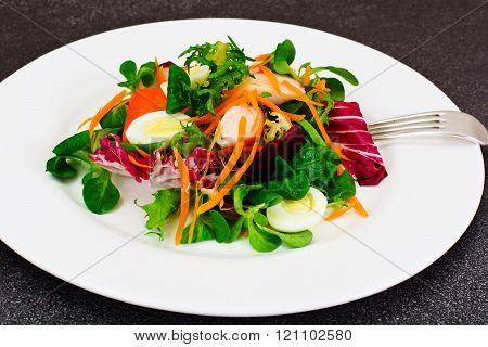 Frise Corn Salad with Chicory, Escarole, Crab Sticks and Quail E