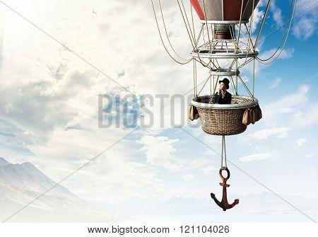 Woman traveling in aerostat