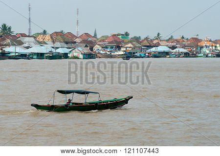 Boat on Musi River July 30, 2011 in Palembang, Sumatra, Indonesia.
