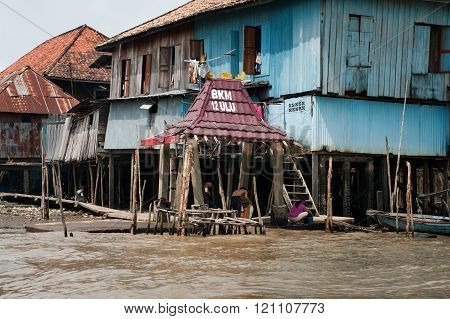 Wooden houses on piles on Musi River in Palembang, Sumatra, Indonesia.