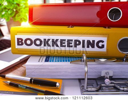 Yellow Ring Binder with Inscription Bookkeeping.