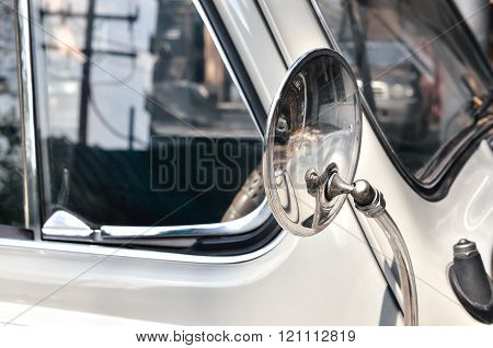 Side rear-view mirror on a old vintage automobile
