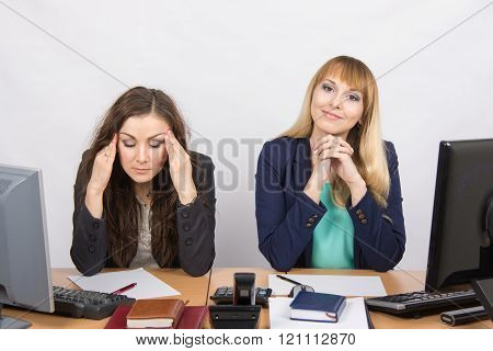 The Situation In The Office - From One Girl Really A Headache, The Other Looks Happy In The Picture