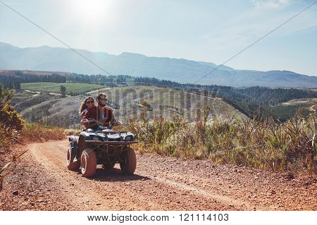 Young Couple Enjoying Off Road Vehicle Ride