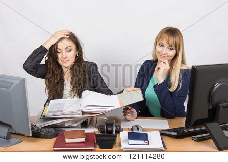 The Situation In The Office - One Employee Watching Folders With Documents And Clutched Her Head, An