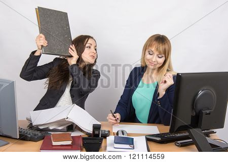 The Girl In The Office Threatens To Hit Another Folder Employee