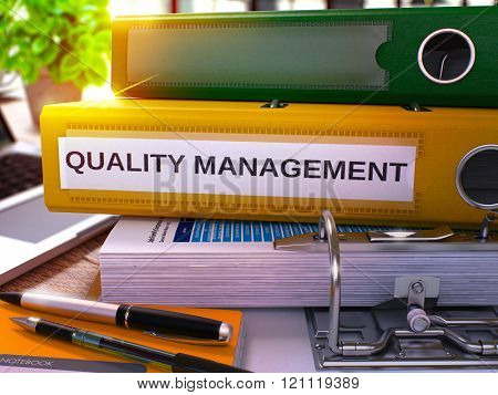 Quality Management on Yellow Office Folder. Toned Image.