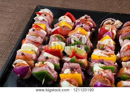 Raw pork skewers ready for grilling - meal food