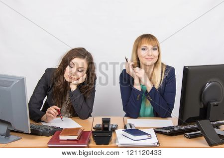The Situation In The Office - A Woman Upset Looking At The Document, The Other Happily Looks Into Th