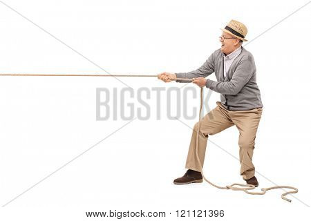 Studio shot of a cheerful senior pulling a rope isolated on white background