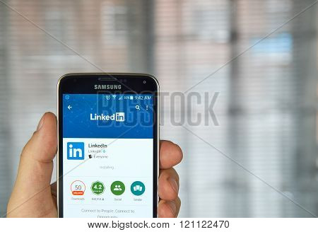 MONTREAL CANADA - MARCH 8 2016 - Linkedin mobile application on screen of Samsung S5 in hand.