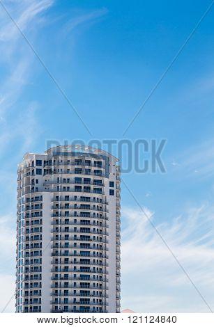 White Condo Tower Under Blue Tropical Sky
