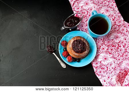 Cup Of Coffee And Pancake With Berry Sauce