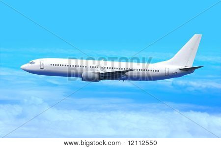 Passenger airplane in the blue sky landing away