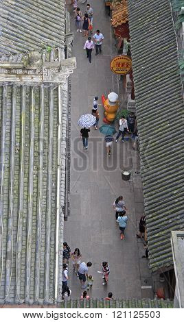people walk on pedestrian street in Chongqing, view from the top