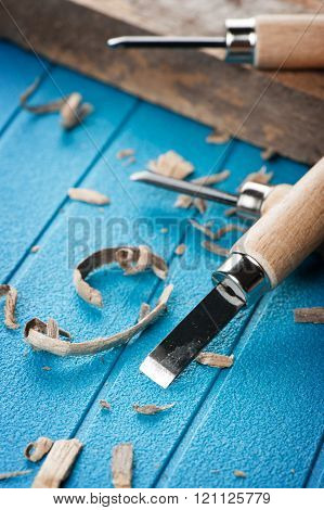 closeup chisels for wood on blue background