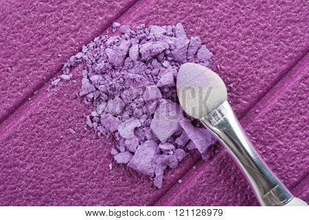 closeup cracked purple eyeshadow, abstract cosmetic cocept