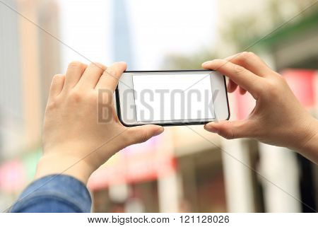 closeup of people hands use cellphone at city