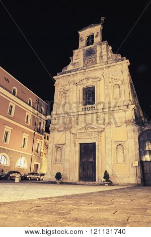 Church Facade With Wall Clock At Night
