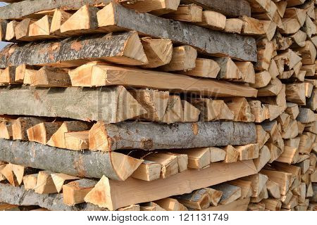 Firewood stacked for winter storage - closeup