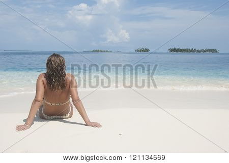 Woman at the beach enjoying vacation, San Blas, Kuna Yala. Panama.