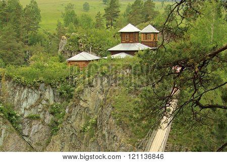 Altai, Russia - June 11, 2012: Suspension Bridge To The Monastery On The Island Of Patmos, Altai, Ru