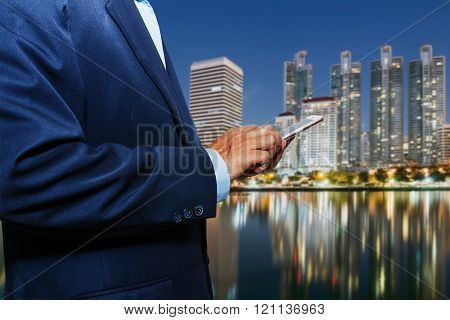 Businessman using touch screen mobile smart phone
