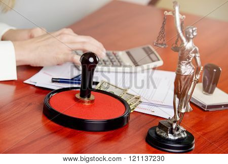 Woman Notary Public Calculates The Cost