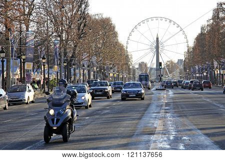 Paris, France -18 December 2011: Avenue Champs-elysees With Ferris Wheel At Horizon In Paris, France