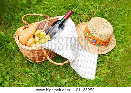 Basket For Picnic With Wine, Croissants, Grape And Picnic Blanket