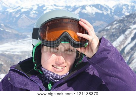 Young Woman Face In Mask And Helmet, Skiing Resort In Austria.
