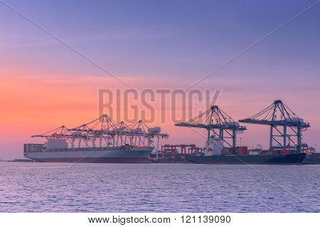 Unloading container shipping at cargo ship terminal.