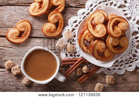 Coffee With Milk And Cookies Palmiers On The Table. Horizontal Top View