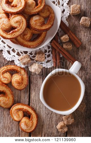 Coffee With Milk And Cookies Palmiers On The Table. Vertical Top View