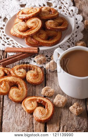Coffee with milk and cookies Palmiers close-up