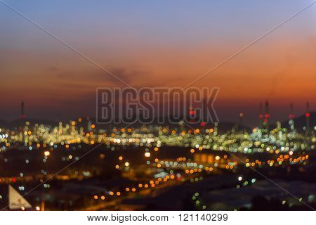 Bokeh of oil refinery plant at twilight Blur background.