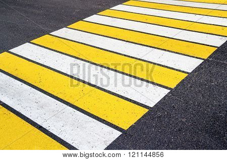 Zebra Crossing With White And Yellow Lines