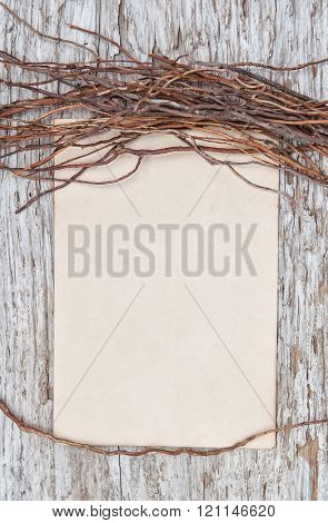 Old Wooden Background With Paper And Dry Branches