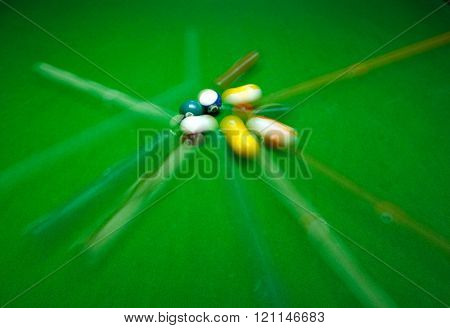 green billiard table with colorful Speedy balls