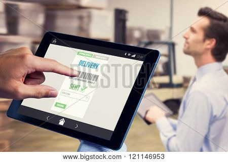 Man using tablet pc against manager using digital tablet in warehouse