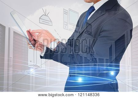 Businessman in suit using digital tablet against composite image of cloud computing doodle