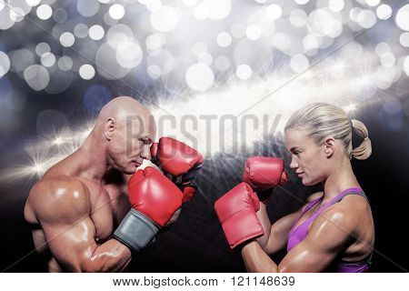 Side view of boxers with fighting stance against spotlights