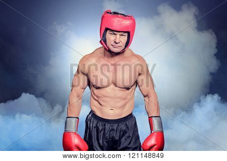 Portrait of shirtless man with boxing headgear and gloves against cloudy sky