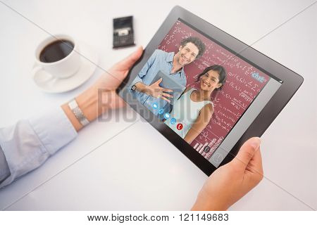 Man using tablet pc against red