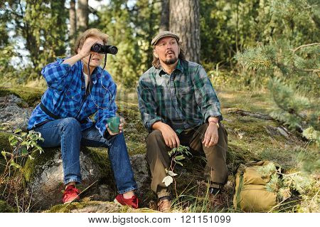 senior couple relaxing in forest